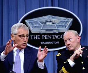 US Secretary of Defense Chuck Hagel and Chairman of the Joint Chiefs of Staff General Martin Dempsey hold a press briefing at the Pentagon