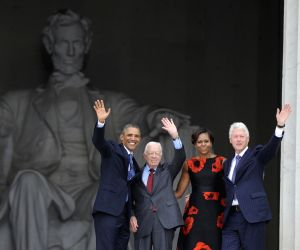 (L-R) U.S. President Barack Obama, former president Jimmy Carter, First Lady Michelle Obama and Bill Clinton wave at the Lincoln Memorial during the ...