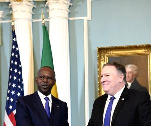 WASHINGTON, Dec. 10, 2018 - U.S. Secretary of State Mike Pompeo (R) and Senegal's visiting Prime Minister Mahammed Boun Abdallah Dionne attend the signing ceremony of the pact between the U.S. ...