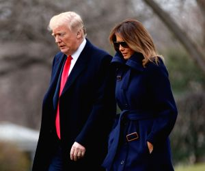 WASHINGTON, March 19, 2018 - U.S. President Donald Trump (L) and First Lady Melania Trump depart the White House in Washington D.C., the United States, on March 19, 2018. U.S. President Donald Trump ...