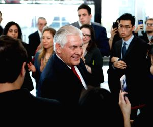 WASHINGTON, March 22, 2018 - Outgoing U.S. Secretary of State Rex Tillerson (C) shakes hands with State Department employees after delivering farewell speech at the State Department in Washington ...