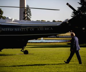WASHINGTON, Oct. 11, 2019 (Xinhua) -- U.S. President Donald Trump leaves the White House in Washington D.C., the United States, on Oct. 10, 2019. U.S. President Donald Trump said on Thursday that he hopes to mediate between Turkey and the Syrian Kurd