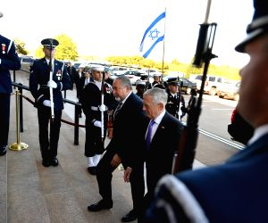 WASHINGTON, Oct. 19, 2017 - U.S. Defense Secretary Jim Mattis (C-R) welcomes Israeli Defense Minister Avigdor Lieberman (C-L) prior to their meeting at the Pentagon in Washington D.C., the United ...