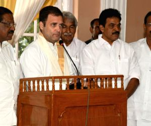 Wayanad: Congress President Rahul Gandhi addresses the Coordination meeting of three parliamentary constituencies of Kannur, Kasaragod and Vadakara, in Kerala's Wayanad, on April 17, 2019. Also seen Congress leaders Oommen Chandy and K. C. Venugopal.