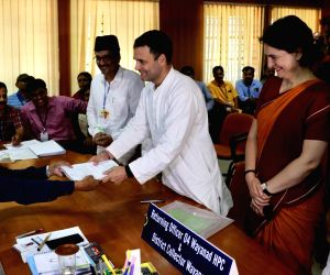 Wayanad (Kerala): Congress President Rahul Gandhi files his nomination for his second seat of Wayanad for the 2019 Lok Sabha elections in Wayanad, Kerala on April 4, 2019. Also seen Congress General ...