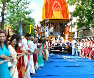 West Bengal Chief Minister Mamata Banerjee and actors Moon Moon Sen and Bhagyashree pull the chariot along with other devotees during Jagannath Rath Yatra at International Society for ...