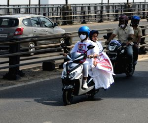 West Bengal Chief Minister Mamata Banerjee riding scooty during protest rally against Central Government in Kolkata