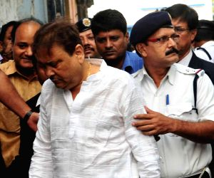 Madan Mitra produced in court