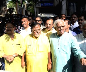 West Bengal's Parliamentary Affairs Minister Partha Chatterjee and other leaders of Trinamool Congress (TMC) come out after meeting State Election Commissioner A K Singh ahead of Panchayat ...
