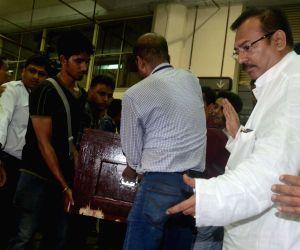 Coffins of Paresh Chandra Nath and Gautam Ghosh at Kolkata airport