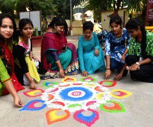 women-busy-making-rangoli-ahead-of-diwali-in