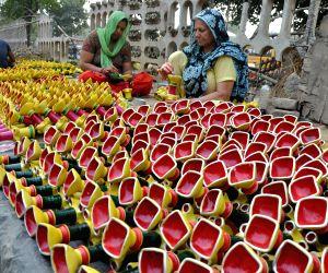 women-busy-painting-earthen-lamps-ahead-of-diwali