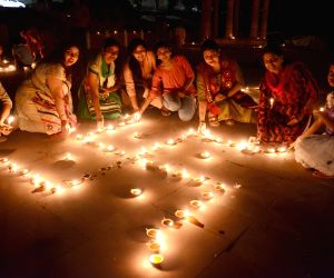 Women celebrate Dev Deepawali in Lucknow on Nov 3, 2017.