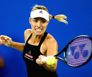 Kerber beats injured Keys, advances at Wuhan Open
