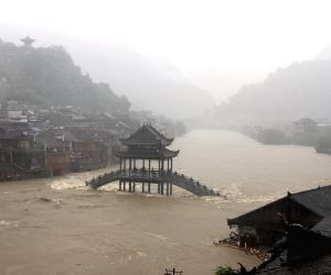 Tourists have been evacuated since Monday night as record downpours hit Fenghuang County