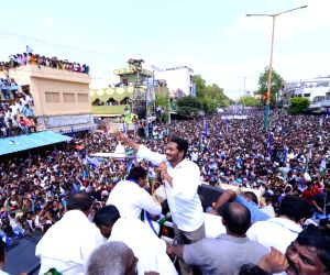 YSR Congress Party chief Y.S. Jaganmohan Reddy seen holding a fan while addressing a public meeting in Andhra Pradesh's Guntur district, on March 24, 2019.