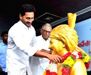 YSRCP president Y.S. Jagan Mohan Reddy pays tributes to Y S Rajasekhara Reddy at YSRC Legislature Party meeting at party president Y.S. Jagan Mohan Reddy's residence in Tadepalli, Andhra ...