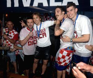 ZADAR, July 18, 2018 - Sime Vrsaljko (1st L), Luka Modric (2nd L), Danijel Subasic (2nd R) and Dominik Livakovic (1st R) of Croatian national football team celebrates on a boat in Zadar, Croatia, ...