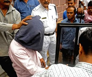 Zafar Khan who has been arrested by the Special Task Force (STF) of Kolkata Police for allegedly working for Pakistani spy agency Inter-Services Intelligence (ISI) being taken to be produced ...