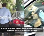 Kartik Aaryan hides face from paparazzi as he is spotted outside Sara Ali Khan's house