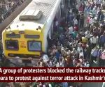 Pulwama attack: Train services hit as scores of protesters block train in Nalasopara