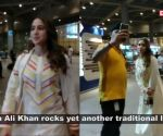 Sara Ali Khan looks bright and chirpy as she gets snapped returning to Mumbai in a cream salwar suit