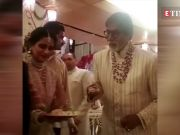 Amitabh Bachchan serves food to the guests at Isha Ambani and Anand Piramal's wedding