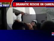 Caught on cam: Dramatic rescue of a man stuck in elevator
