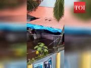 Caught on cam: Hotel employee washes plates in polluted flood water
