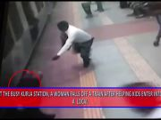 Caught on camera: Mother falls off train, reunited with kids later