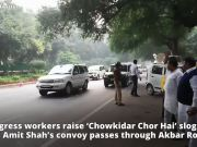 Congress workers raise 'Chowkidar Chor Hai' slogans, as Amit Shah's convoy passes through Akbar Road