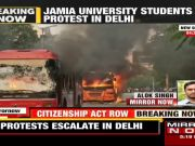 Delhi: Anti-CAA protesters set fire on Bbuses, Jamia Millia Islamia students blamed