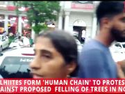 Delhiites form 'human chain' to protest against proposed felling of trees in NCR