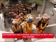Devotees throng Lord Ayyappa temple despite heavy floods