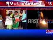 Karnataka polls: Politicians distribute freebies, voters burn them