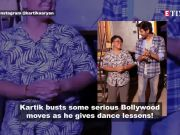 Kartik Aaryan gets into the groove as he gives a master class in Bollywood dance to a girl in Bangkok