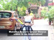 Malaika Arora shows her perfect midriff as she stretches in sports bra and gym shorts