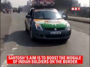Man drives car in reverse direction to boost morale of soldiers; flouts traffic rules