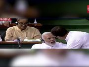 Motion of no confidence: Rahul Gandhi walks to PM Narendra Modi in Lok Sabha, hugs him