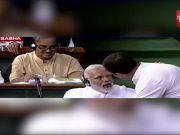 Motion of no confidence: Rahul Gandhi walks to PM Narendra Modi in Lok Sabha, hugs him