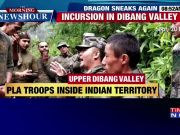 PLA troops display Chinese flag inside Indian territory