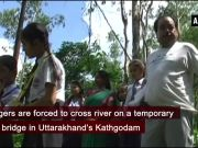 Uttarakhand: In absence of bridge, villagers risk their lives to cross river in Kathgodam