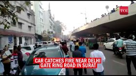 Watch: Car catches fire in Surat, traffic movement affected