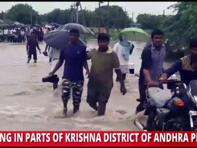 Andhra Pradesh floods: Villagers risk their lives by crossing partially submerged bridge