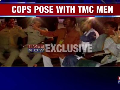 Cops flash victory sign with TMC leaders