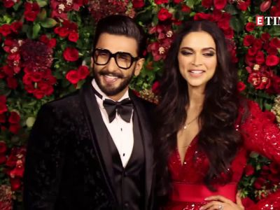 Deepika Padukone leaves Ranveer Singh blushing as she plants a kiss on his cheek!