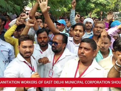 Delhi: Striking sanitation workers of EDMC hold protest, demand payment salary