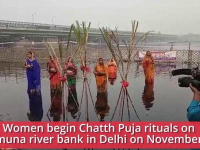 Delhi: Women perform Chhath Puja at Yamuna river bank