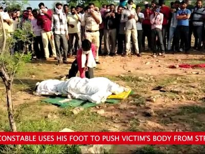 MP cop pushes dead body off stretcher with foot, suspended