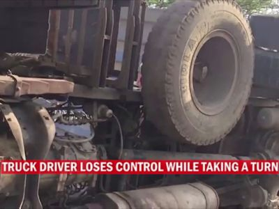 Navi Mumbai: Container truck topples after driver loses control